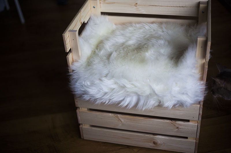 a simple and stylish cat bed made of a couple of Knagglig boxes and some faux fur