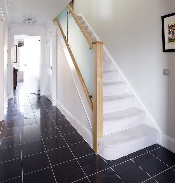 a frosted glass staircase looks very modern and bold and adds a touch of edge to your space