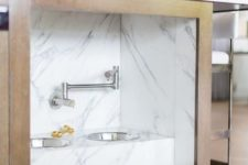 23 a kitchen island with an integrated pet food station done with marble contact paper is a stylish idea