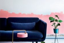 23 a living room with a catchy half pink wall and a refined navy velvet sofa