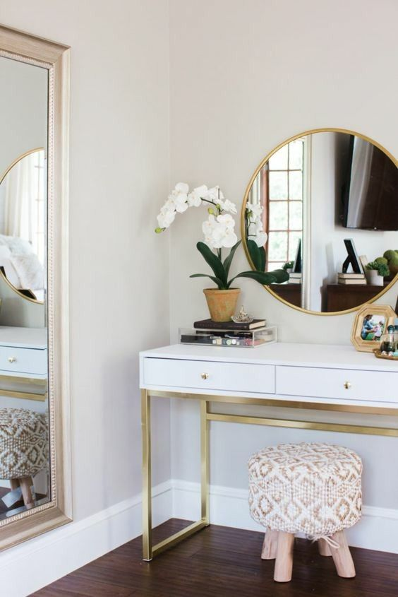 a stylish and elegant vanity with an upholstered stool, which doens't take much space