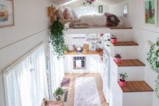 23 colorful rugs and potted plants plus curtains immediately cozy up the small home