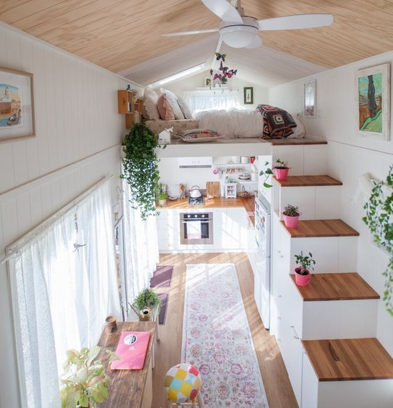 colorful rugs and potted plants plus curtains immediately cozy up the small home