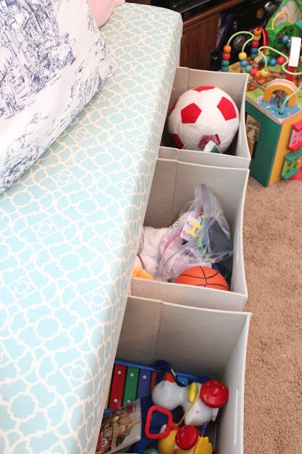 place stome Drona boxes under the kid's bed to add comfy storage and delcutter the room