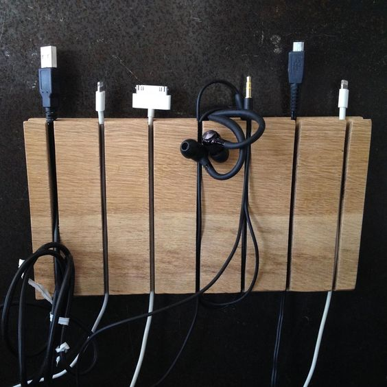 such a magnetic strip can be used to organize the cords, too, it's a stylish and modern idea