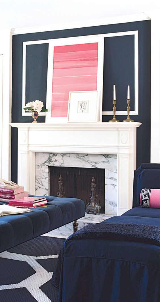 a navy and white living room with touches of hot pink is a bright and sophisticated idea