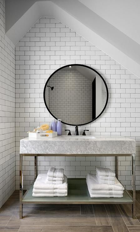 a vanity of a stone top and a frosted glass shelf underneath looks contemporary and bold