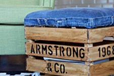24 an industrial ottoman made of a stained Knagglig box with letters, with a denim seat and casters
