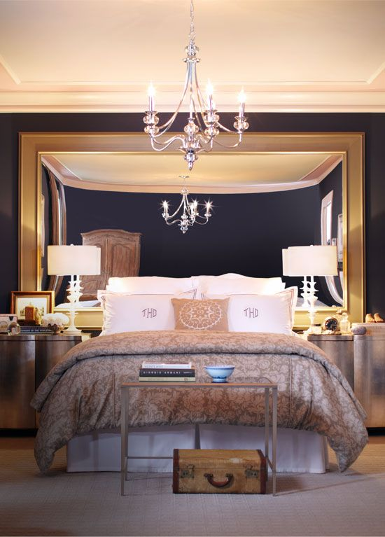 an oversized mirror instead of a headboard is a unique and very creative idea to try