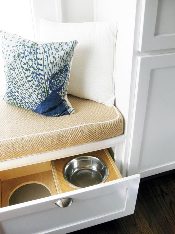 an upholstered kitchen windowsill bench can contain drawers with your pets' bowls