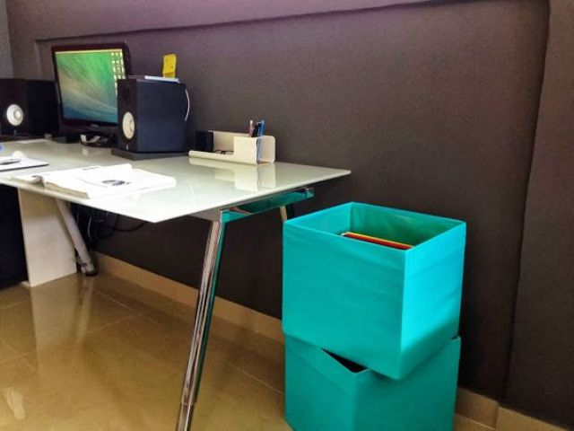 colorful Drona boxes can be placed next to the desk to use them for file storage or your filing system