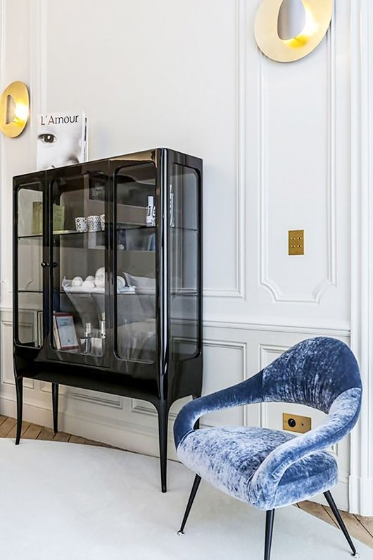 such a smoked glass cabinet is a fresh and modern take on a refined vintage furniture piece
