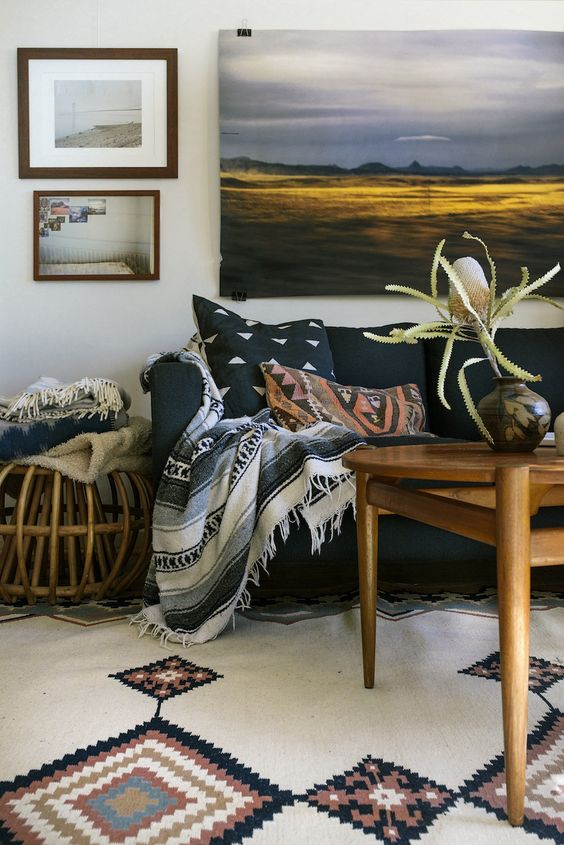 tribal textiles and rugs are amazing for sprucing up a neutral living room