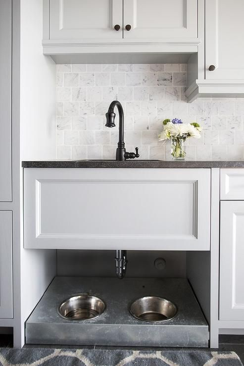 a sink cabinet with a pet food station underneath is a smart way to feed your pet with comfort