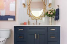 25 a stylish bathroom with a navy vanity, a blush printed rug and a catchy artwork that ties them both