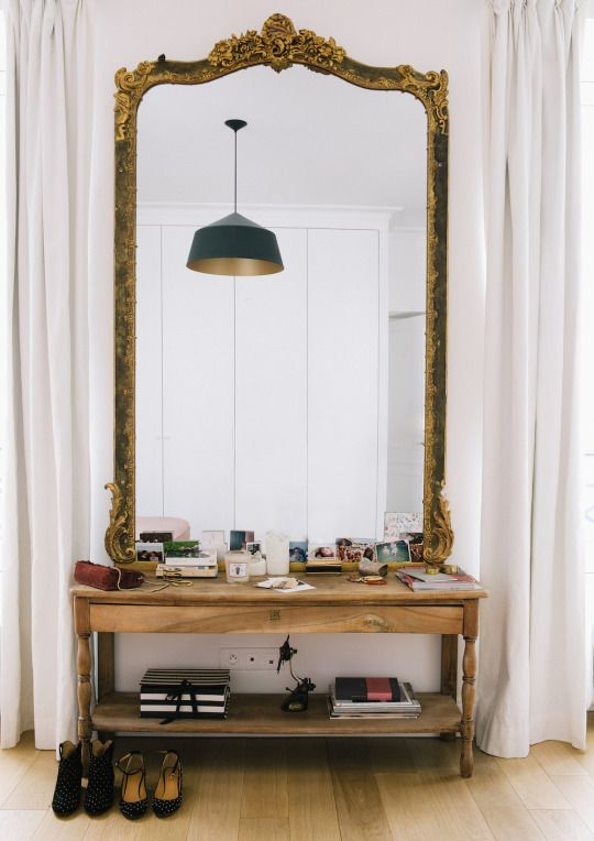 an entryway definitely needs a large mirror, it's a must here and it's time to go for one this year