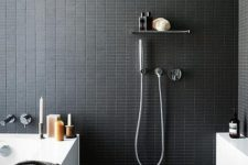 25 catchy small black tiles on the walls give your bathroom a sexy feel, and grey tiles on the floor make it calmer