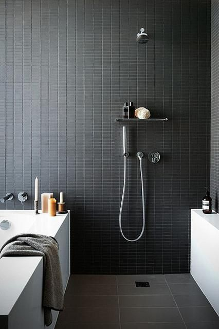 catchy small black tiles on the walls give your bathroom a sexy feel, and grey tiles on the floor make it calmer