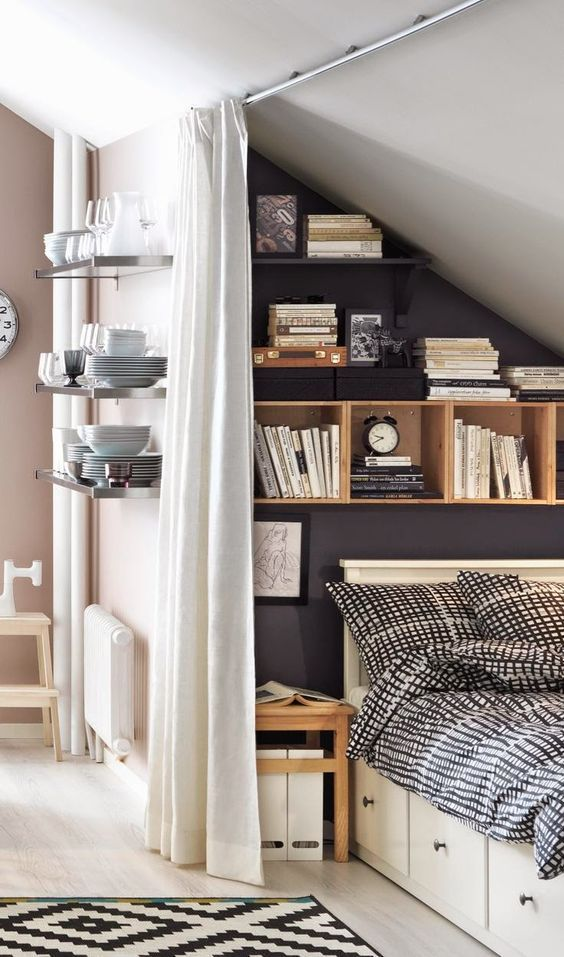 floating and box shelves over the bed and storage drawers in the bed