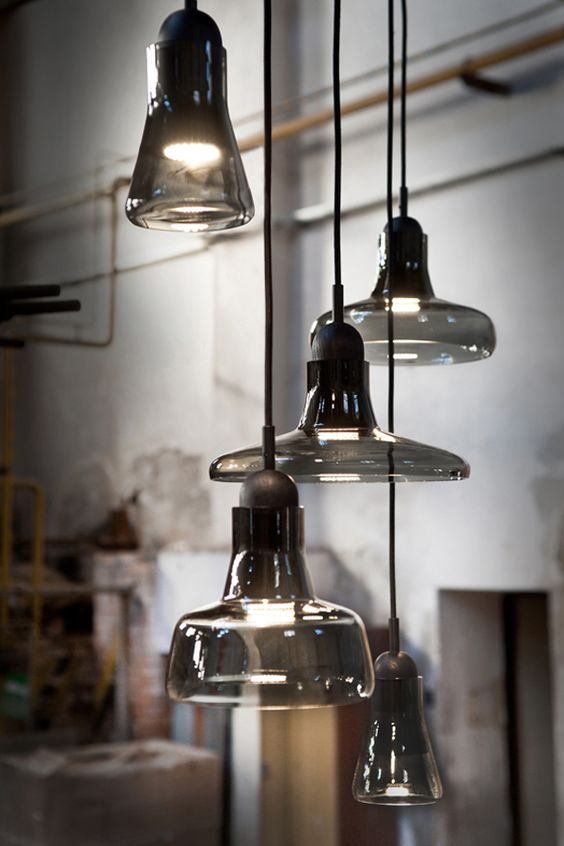 such a smoked glass pendant lamps cluster will bring an edgy feel to any space in your home