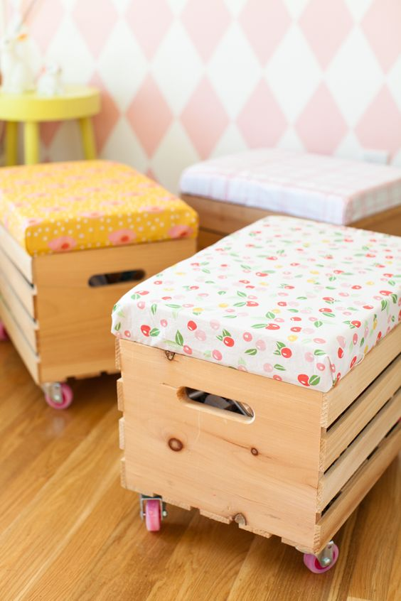Knagglig boxes placed on colorful casters and with colorful upholstered seats is a fun idea