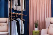 26 a navy closet with pink drapes and neutral furniture plus metallic touches looks very glam-like