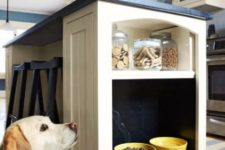 26 integrate a pet feeding alcove into your kitchen island and make a small shelf with dog treats above it