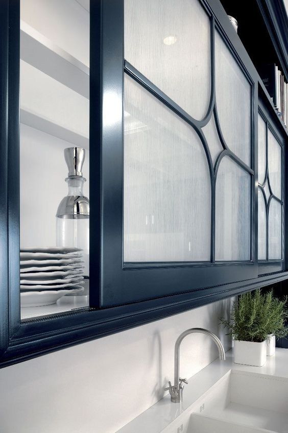 sliding screen doors with frosted glass and black touches for a refined and chic kitchen cabinet