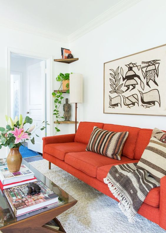 spruce up a bold sofa with tribal patterns to make it look creative and bold