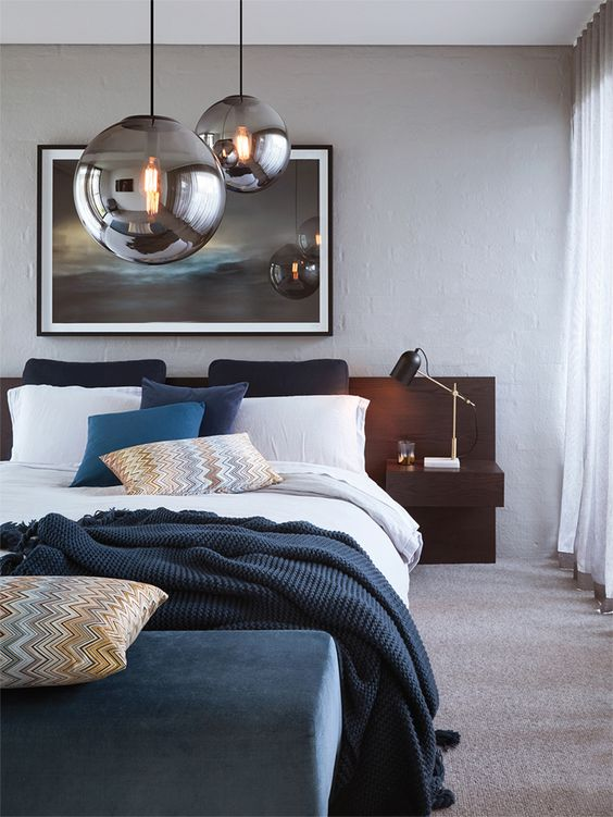such gorgeous smoked bulb pendant lamps over your bed will make a cool statement