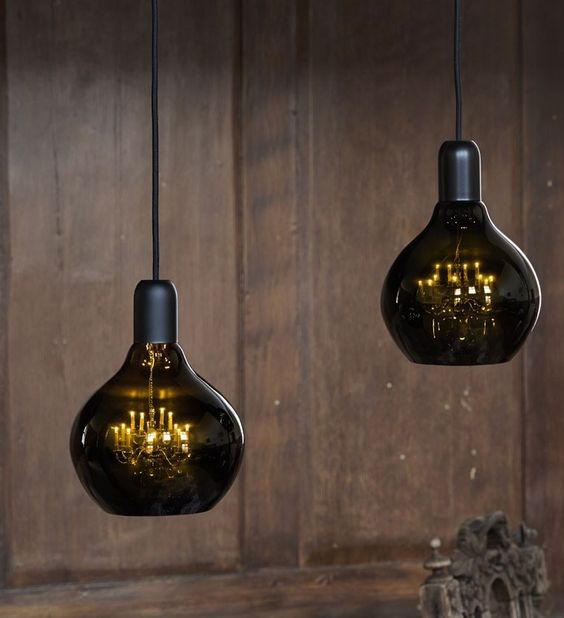 unique pendant lamps of smoked glass and with vintage refined chandeliers inside will be a conversation starter in your space