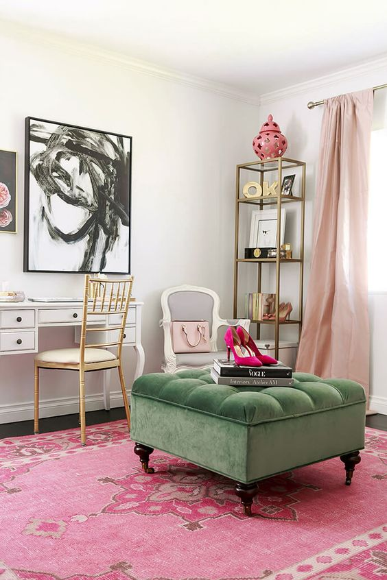 a soft green velvet ottoman brings a refined touch to the girlish room and a contrasting shade