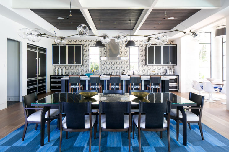 This gorgeous beach home pairs traditional and modern and features a cool color palette with blues