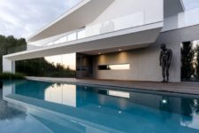 01 This gorgeous house features contemporary style, clean lines, moody colors and lots of works of art