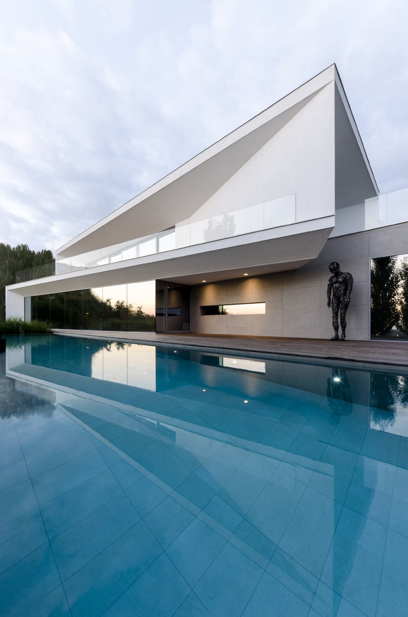 This gorgeous house features contemporary style, clean lines, moody colors and lots of works of art