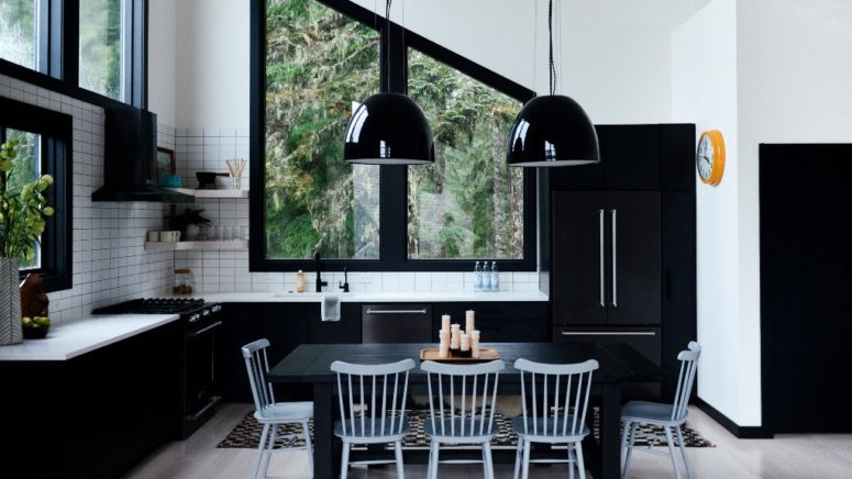 The dining room and kitchen space is done in a monochromatic color scheme, it's black and white