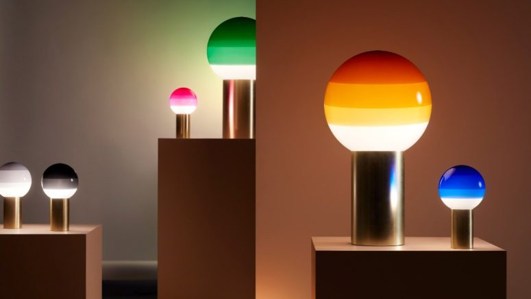 The lamps show off various colors, from grey to emerald and several sizes