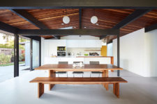 02 The main space is an open layout with a kitchen, dining and living space, with a glazed wall and skylights