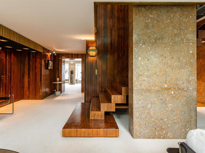Wood, steel, stone, terrazzo and glass make up a stylish modern duplex with a touch of chic