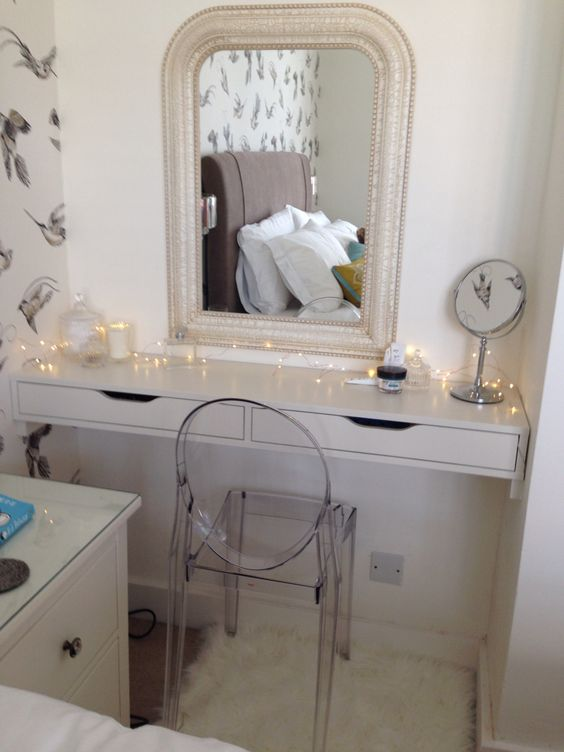 a built in dressing table of an Ekby Alex shelf in the corner and an acrylic chair