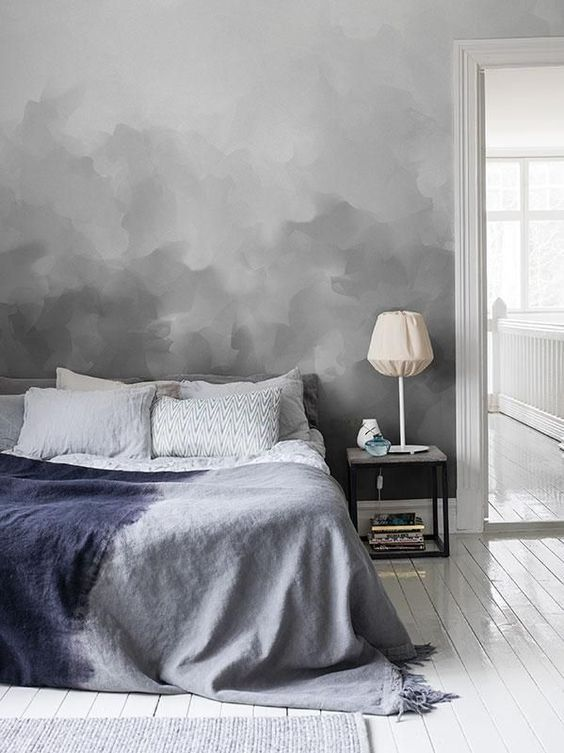 a grey ombre wall can be easily recreated in your bedroom, it's a cool soothing color and a trendy way to work with color