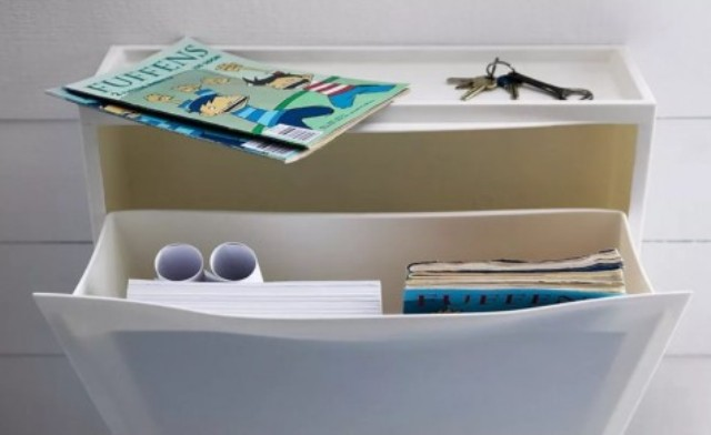 an IKEA Trones piece is a perfect skinny floating storage console for a small entryway