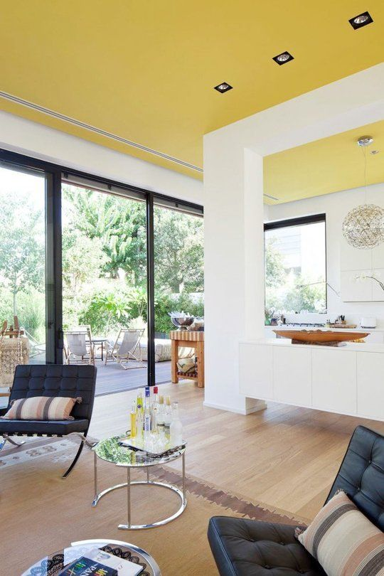an unexpected sunny yellow ceiling creates a feeling of sunshine in the house everytime you look at it