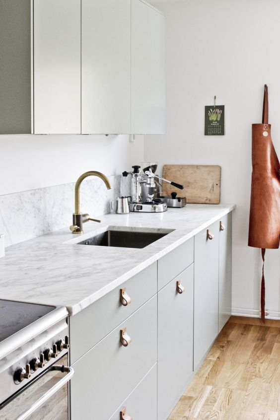 leather handles will add an edgy touch to your kitchen giving it a modern feel at once