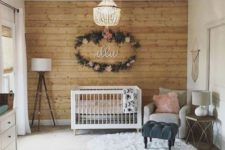 02 make a statement wall clad with wood for a cozy rustic touch in your baby's space