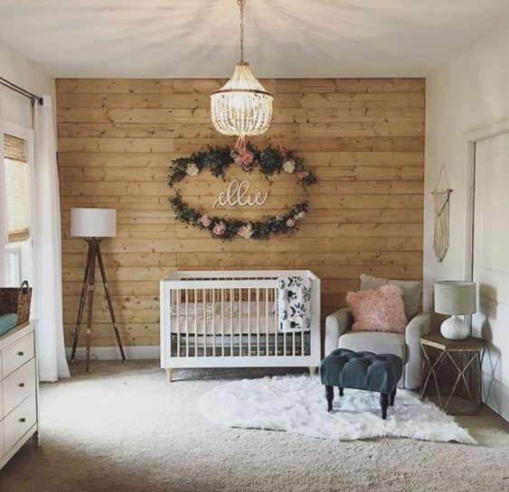 make a statement wall clad with wood for a cozy rustic touch in your baby's space