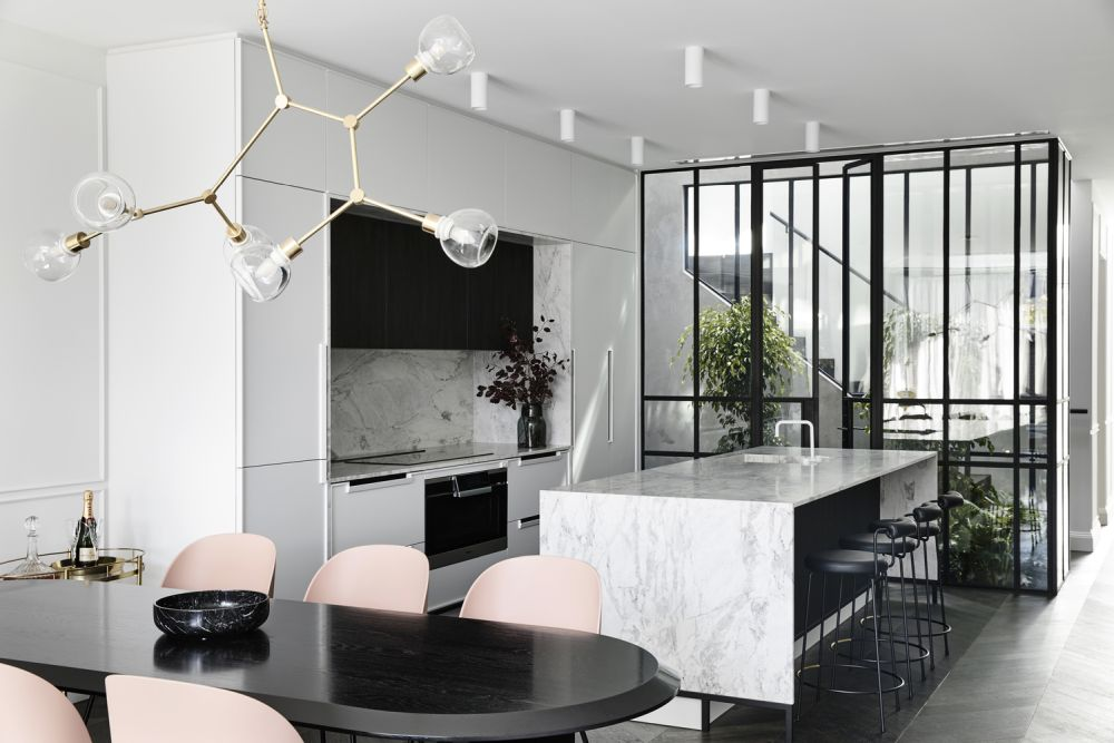 a contemporary kitchen design with stone countertops