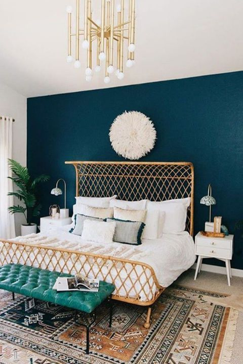 a neutral bedroom can be spruced up with a navy statement wall for a chic and bold look