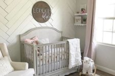 03 a statement wall clad with whitewashed wood is a great idea for a neutral or pastel nursery