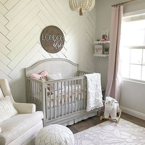 a statement wall clad with whitewashed wood is a great idea for a neutral or pastel nursery
